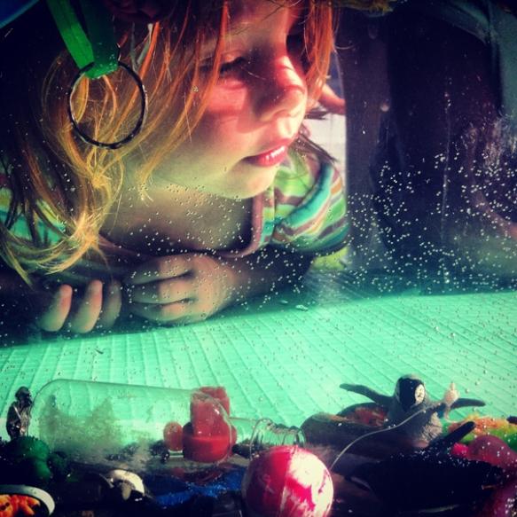child looking at marine debris exhibit